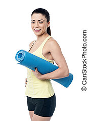 Beautiful woman with a yoga mat