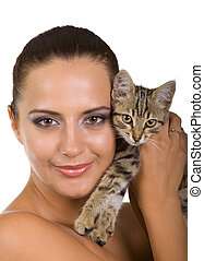 Beautiful woman with adorable kitten