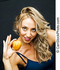 Beautiful  Woman with an apple in hand