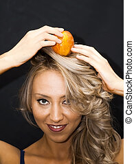 Beautiful  Woman With an apple on her head