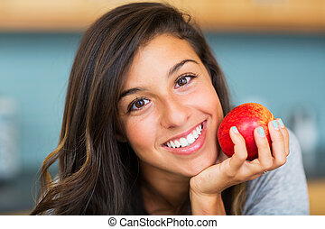 Beautiful woman with an apple