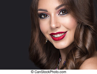 Beautiful woman with arabic make-up, red lips and curls....