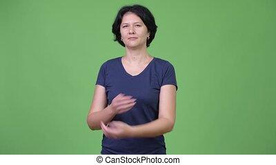 Beautiful woman with arms crossed - Studio shot of beautiful...