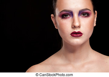 Beautiful woman with artistic professional make up