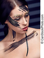 Beautiful woman with artistic unusual makeup