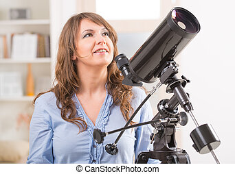 Beautiful woman with astronomical telescope