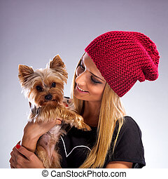 Beautiful woman with autumn fashion - Embracing yorkshire terrier dog
