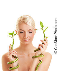 Beautiful woman with bamboo plant