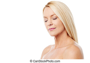 Middle aged woman enjoying with clean healthy skin