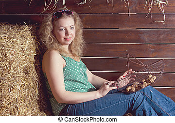 beautiful woman with basket on haystack