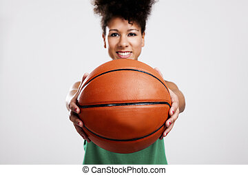 Beautiful woman with basketball