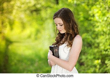 Beautiful woman with Bible