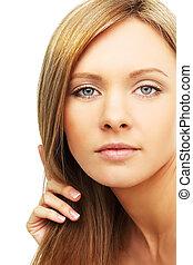 Beautiful woman with blond hair - face closeup