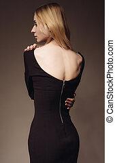 beautiful woman with blond hair wearing little black dress