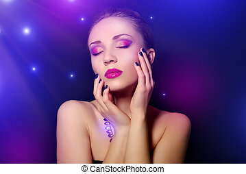 Beautiful woman with blue nails and creative makeup