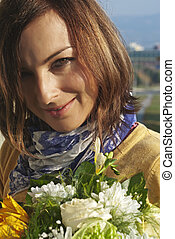 Beautiful woman with bouquet in hands