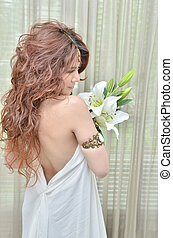 Beautiful woman with bouquet lily flowers