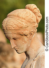 beautiful woman with bowed head - classic sculpture,...
