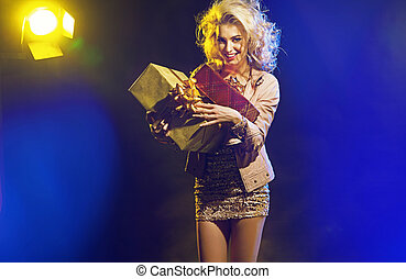 Beautiful woman with bunch of gifts