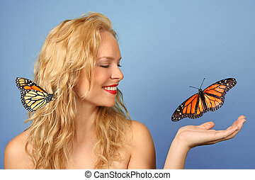 Beautiful Woman With Butterflies in Her Hand and Hair