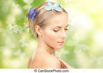 beautiful woman with butterfly in hair