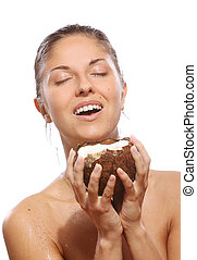 Beautiful woman with coconut in hands