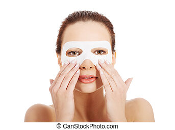 Beautiful woman with collagen mask.