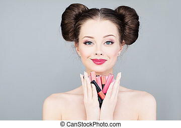 Beautiful Woman with Colorful Lipsticks. Fashion Makeup Concept