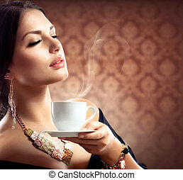 Beautiful Woman With Cup of Coffee or Tea