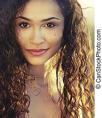 Beautiful woman with curly hair - Portrait photo of...