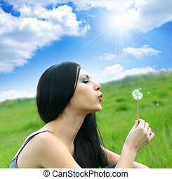 beautiful woman with dandelion