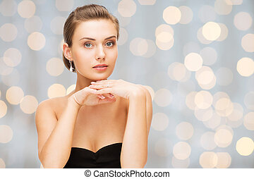 beautiful woman with diamond earrings and bracelet