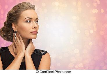 beautiful woman with diamond earrings