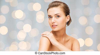 beautiful woman with diamond earrings and bracelet