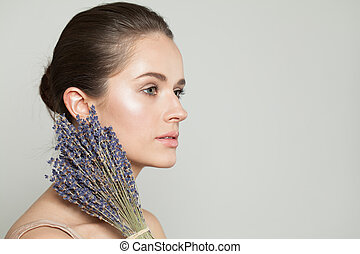 Beautiful woman with dried lavender flowers