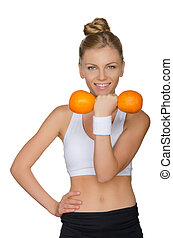 Beautiful woman with dumbbells two oranges