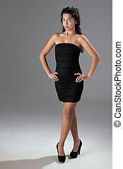 beautiful woman with elegant black dress, studio shot
