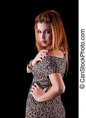 beautiful woman with elegant dress, isolated on black, studio shot