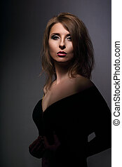 Beautiful woman with elegant neck and shoulder in fashion...