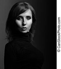 Beautiful woman with elegant neck in fashion black clothing...