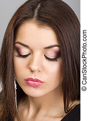 Beautiful woman with evening make-up