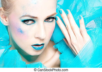 beautiful woman with extreme colorful make up
