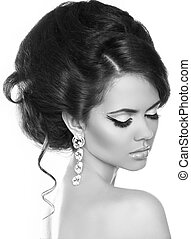 Beautiful woman with fashion hair and evening make-up. Jewelry and Beauty. Black and white photo