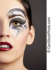 Beautiful woman with fashion makeup