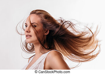 beautiful woman with flowing hair on a white background