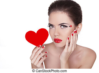Beautiful woman with glamour bright makeup holding red heart isolated on white background. Manicured nails and Red Lips. Valentines Day