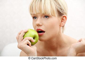 Beautiful woman with green apple
