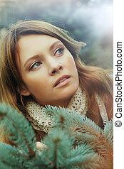 Beautiful woman with green fir - Christmas concept