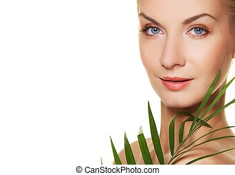 Beautiful woman with green plant