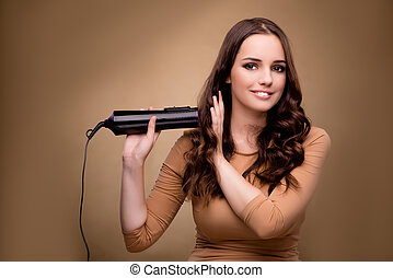Beautiful woman with hair dryer